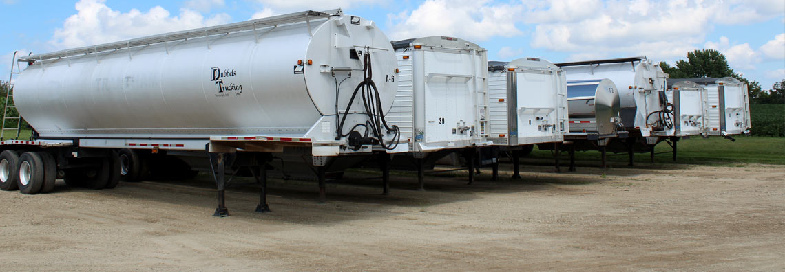 Group of various freight hauling trailers